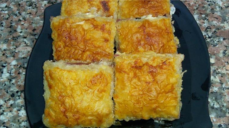 منيو غداء اليوم طريقة عمل الجلاش الحادق بالجبنة والزيتون