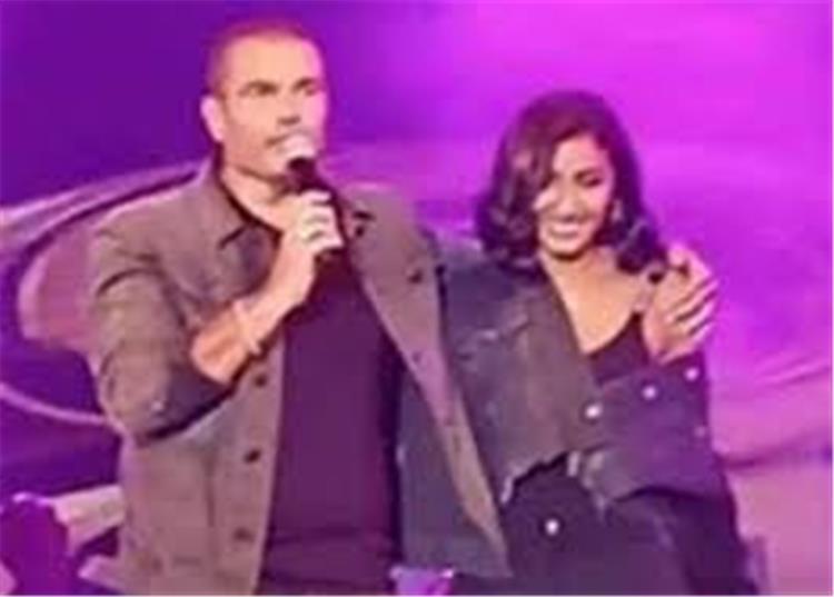 عمرو دياب يعلن حبه لدينا الشربيني لأول مرة على المسرح بأغنية برج الحوت بالفيديو