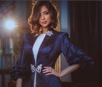 استوحي إطلالتك بالعباءة من أزياء بسمة بوسيل في آخر أيام رمضان